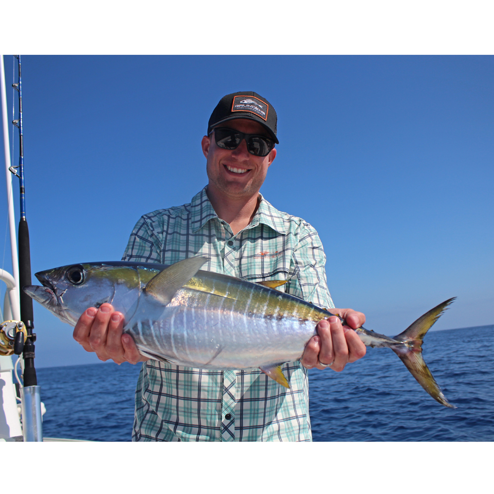 Sport fisherman holding a yellow fin tuna